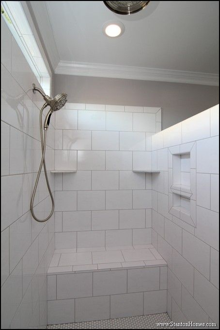 white shower with oversized tiles two shower heads one wall shower and one rain - Ceiling Shower Head