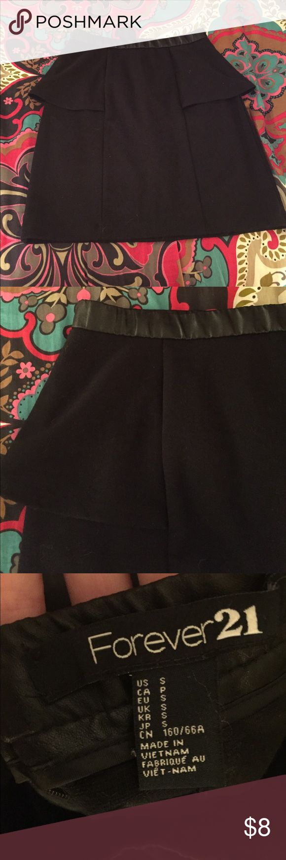Fitted peplum skirt Fitted black peplum skirt. Leather strip around the waist for a cute detail. Made mostly of polyester, also has rayon and spandex for stretch. Bought and wore once. Forever 21 Skirts Mini