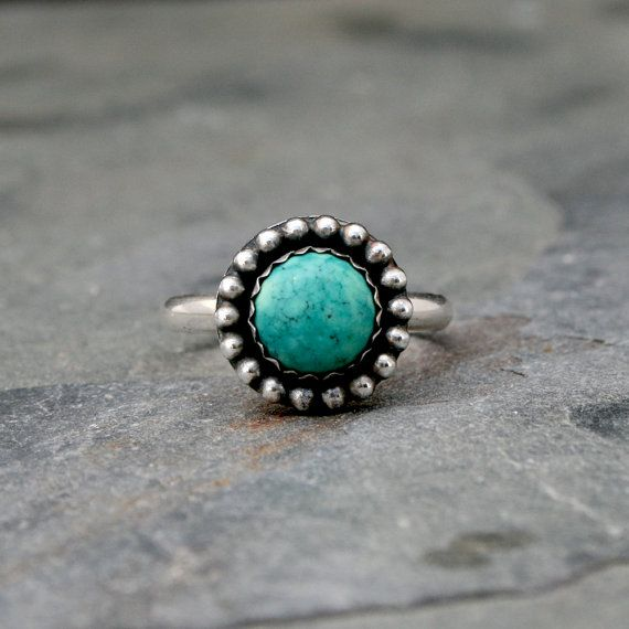 Desert Sky Turquoise Ring  Round turquoise cabochon set in sterling silver, surrounded by a constellation of silver dots. Oxidized and polished to
