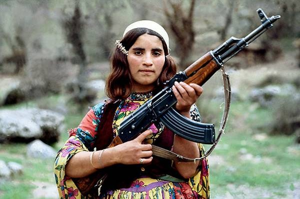 Zagros Mountains, northern Iraq, 1979    Kurdish girl in northern Iraq, using automatic gun, to protect her family from Iraqi troops.(Alex Bowie / Getty)