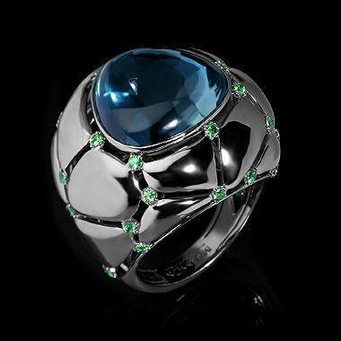 Mousson Atelier, collection Geometry, ring, Black gold 750, London topaz 18,41 ct., Tsavorites