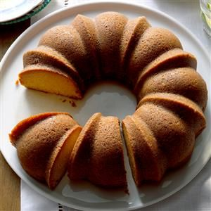 Caribbean Coconut Rum Cake Recipe -My take on those boozy treats that weigh down suitcases returning from Jamaica, this moist cake packs a rum punch. You may wish to card your guests before serving...the longer the rum soaks in, the better. Overnight is best. —Jenn Hall, Collingswood, New Jersey