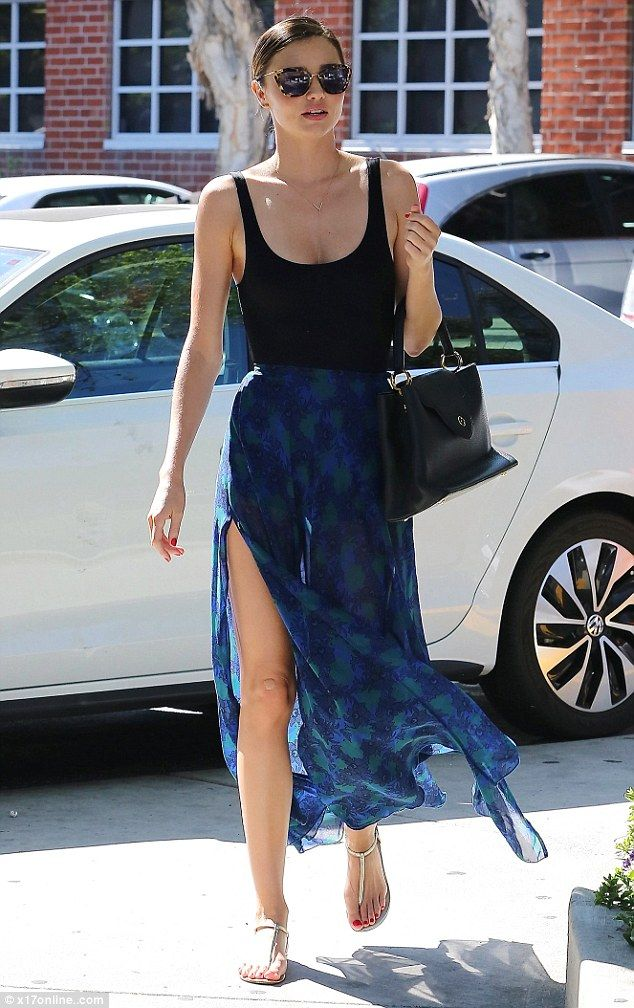 Babing and braless: Miranda Kerr made running errands look positively breezy as she floate...    47      17