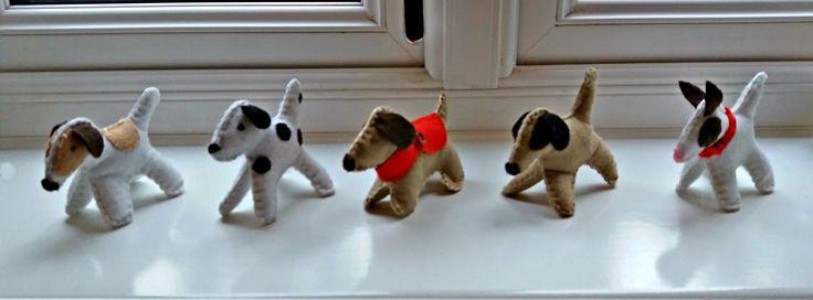 Cute little felt dogs all in a row!
