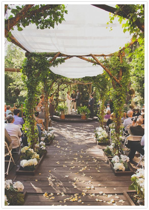 A unique outdoors wedding venue for an eco-themed wedding. Quite unusual to see an aisle covering so elaborate.