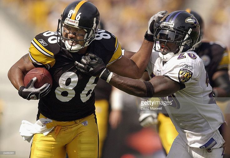 Wide receiver Heinz Ward #86 of the Pittsburgh Steelers pushes away from the tackle attempt of safety Ed Reed #20 of the Baltimore Ravens on September 7, 2003 at Heinz Field in Pittsburgh, Pennsylvania. The Steelers defeated the Ravens 34-15.