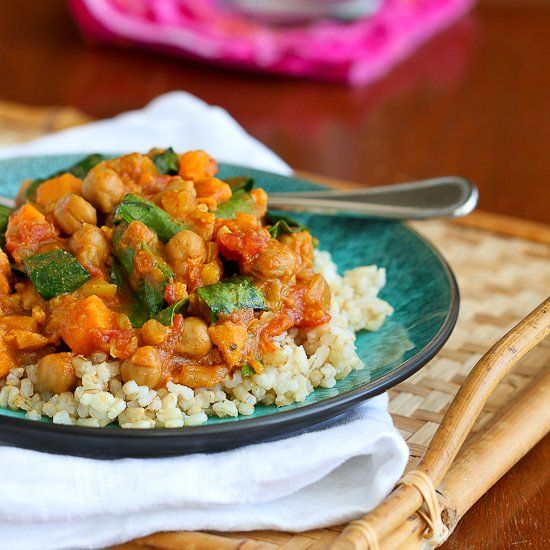 This slow cooker vegan curry recipe stars sweet potato and chickpeas, and is a fantastic choice for a Meatless Monday meal.