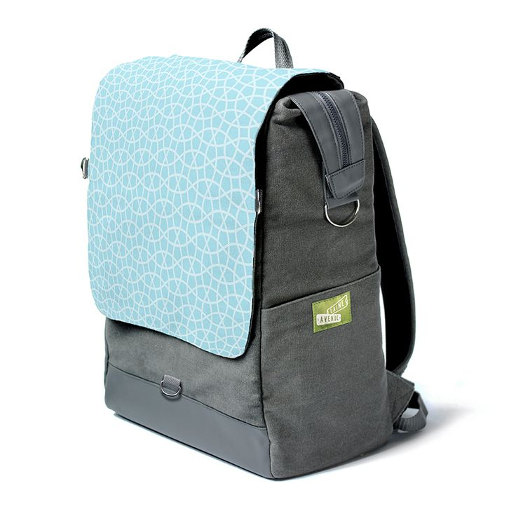 You love geometry. Admit it. You are looking at the most unique backpack on the whole entire planet. Really. It's roomy. It holds all your stuff with our widemouth zip top. It protects your laptop or tablet with a padded sleeve, and best of all, The Crossbody Convertible Flap zips off to become a purse, (with the included cross body strap) for when you need just a few of your favorite things things and not all your stuff.