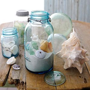 Collect seashells in mason jars and place on the mantel.