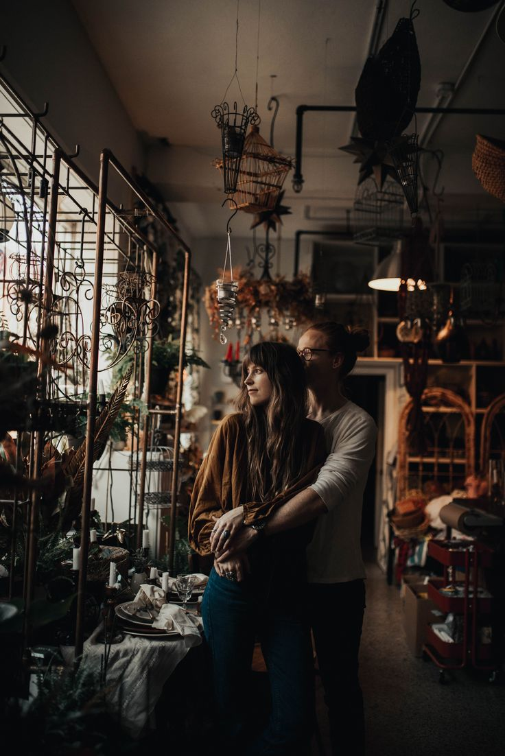Couple session in floral shop. Moody and romantic session, in casual outfits for engagement session. Kansas City wedding photographer. Warm and earthy…