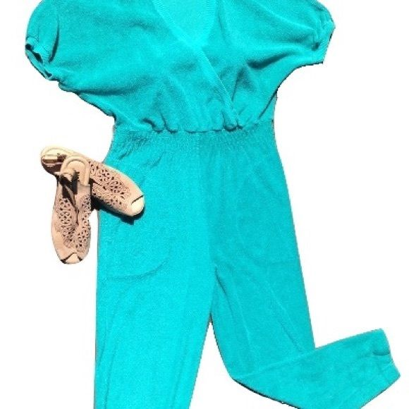 "Retro 70s Terry cloth Jumpsuit turquoise Festival Pre-loved 70s era jumpsuit, play suit, romper-whatever you call it--it's cute, sexy, and a statement piece!  Best fit small-med.  Inseam is 38"". Small quarter sized fade discoloration on one leg-barely noticeable when worn. Tapered leg, cross-over top, elastic waist.  Two front pockets.  Pair it with some wedges and a large brimmed hat or sport it at the beach or pool for a cover up! Vintage Pants Jumpsuits & Rompers"