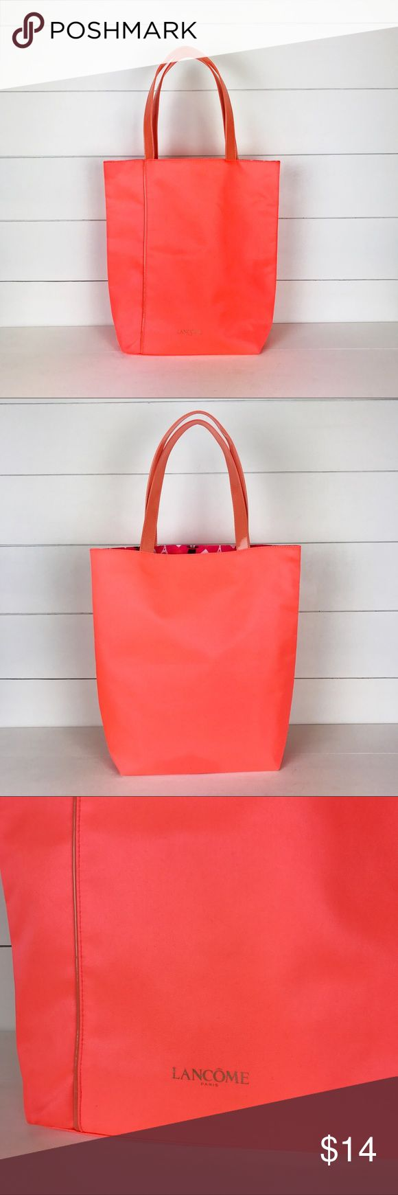 Lancome Bright Orange Tote Bag Lined Lips Paris Super cute bright orange Lancome tote bag.  Pristine condition with cute straps and a liner with Eiffel Tower, lipstick, rose and top hat pattern. Lancome Bags Totes