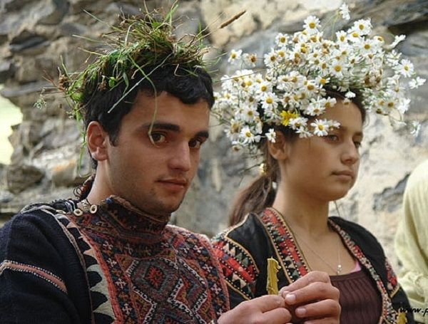 Young couple during a traditional ceremony (wedding?), wearing the traditional costumes of the Khevsureti region (Khevsureti, NE-Georgia).  Clothing style: early 20th century.