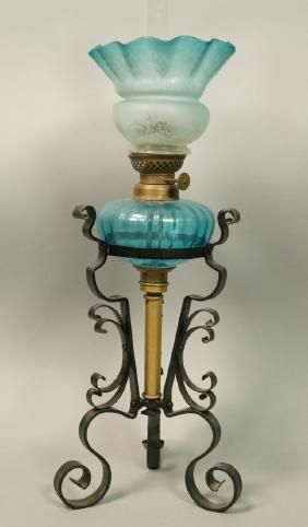 Lot: Black Iron Base Oil Lamp. Blue glass shade and we, Lot Number: 0171, Starting Bid: $40, Auctioneer: Uniques & Antiques, Inc., Auction: Decorative Arts, Books and Local Estates, Date: April 11th, 2017 EDT