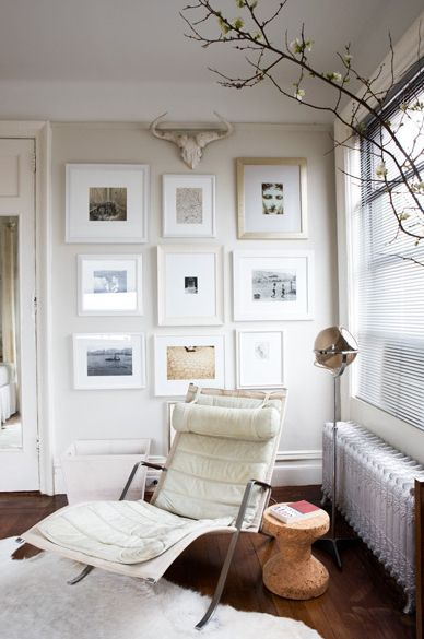 I love the gallery wall mixed with the modern chair.