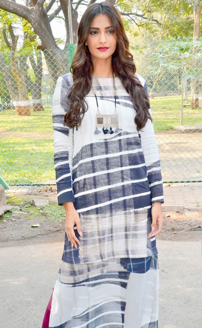 Sonam Kapoor paired a long blue and white tunic with thigh-high bordeaux-coloured boots.