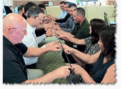 Helium Stick torn Helium Stick: Team Building Activities for Adults