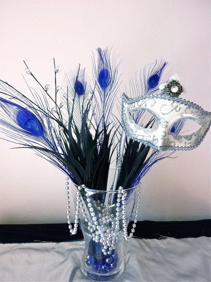 Fantastic Masquerade Party Centerpiece: feathers, mask, beads, etc http://www.mybigdaycompany.com/masquerade-ball.html