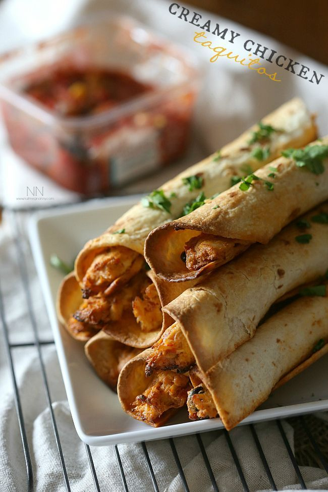 These creamy chicken taquitos are packed full of cream cheese, rotisserie chicken, salsa and lots of shredded pepper jack cheese. | via @nutmegnanny