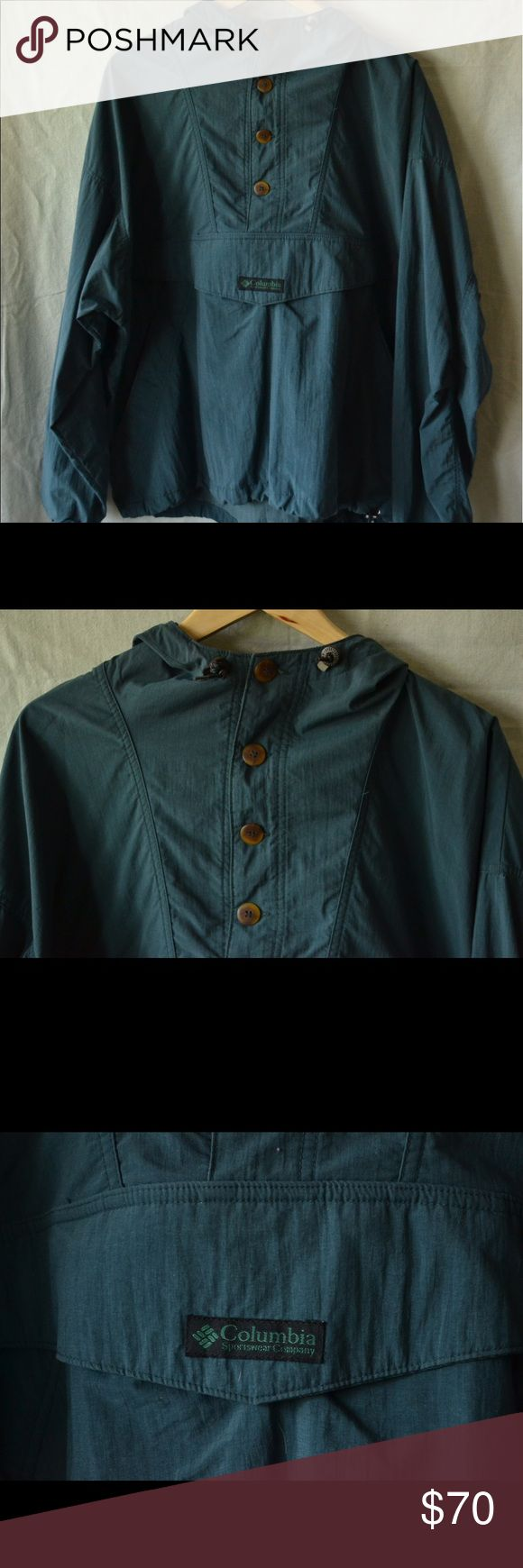 Vintage Teal Columbia Pullover Windbreaker, M/L Amazing Vintage Columbia Pullover Windbreaker. Interesting material texture plus has really cool wooden buttons and three color string pulls. Center stomach pocket. This thing could be perfect for a period indie film. Size tag has worn away, fits like a M/L. Columbia Jackets & Coats Windbreakers