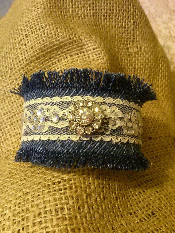1 Inch cuff bracelet with rhinestone embellishments on lace and denim.  The wearer of this bracelet should always remember that the denim