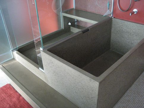 images of concrete bathtub and shower with bench