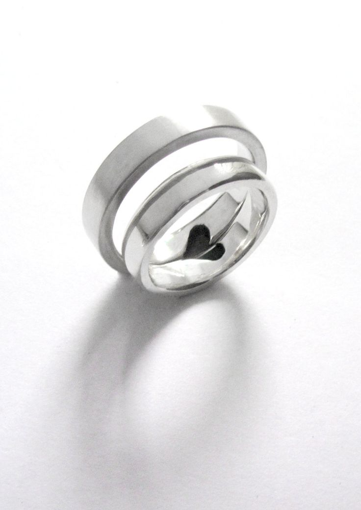 Sterling silver set of rings with half a heart joined to make a whole heart<3