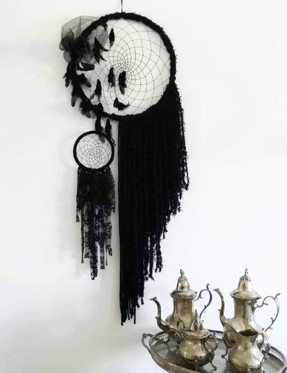This beautiful and very eye catching black boho dream catcher would fit perfectly in a boho bedroom decor style room. This giant dream catcher would also be ideal for someone who likes to combine gothic wall decor with a touch of bohemian decor style in his home.  Made out of black good quality yarns I have straight crocheted the metal hoop and created the web using black cotton thread. Black yarns hang on the one side whilst a small lace dream catcher hangs from a silver chain on the other…