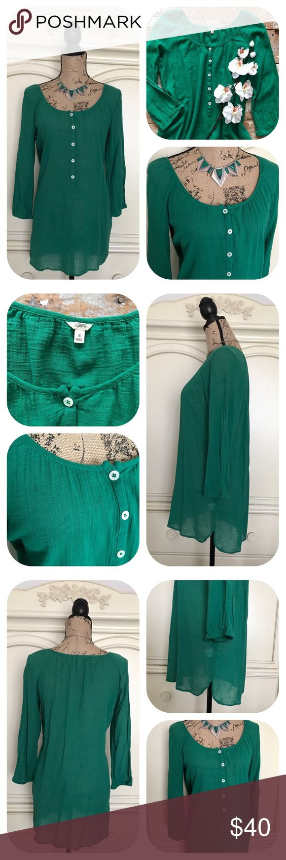J.Crew Whisper Gauze Beachcomber Tunic in Green This J.Crew Whisper beachcomber tunic is an easy-breezy essential in their famous cotton gauze. Super cute peasant style green top w/ graceful gathers at the wide neckline, 5 button-up placket, high-low bottom cut, semi-sheer, 3/4 sleeves. A billowy warm-weather favorite, it layers beautifully over bikinis or tank & shorts. Hits at mid-thigh. In excellent clean condition. Size Small. 100% cotton 🎈No holds/trades 🎈No lowball offers, open to…