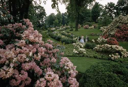 A woman stands in a formal garden near the Battle of Concord site, David Boyer.
