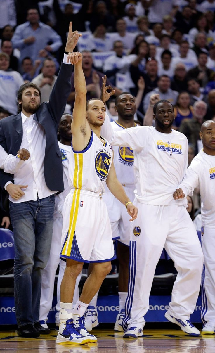 The Warriors bench waits in anticipation as Stephen Curry puts up a three. (PS – it went in)