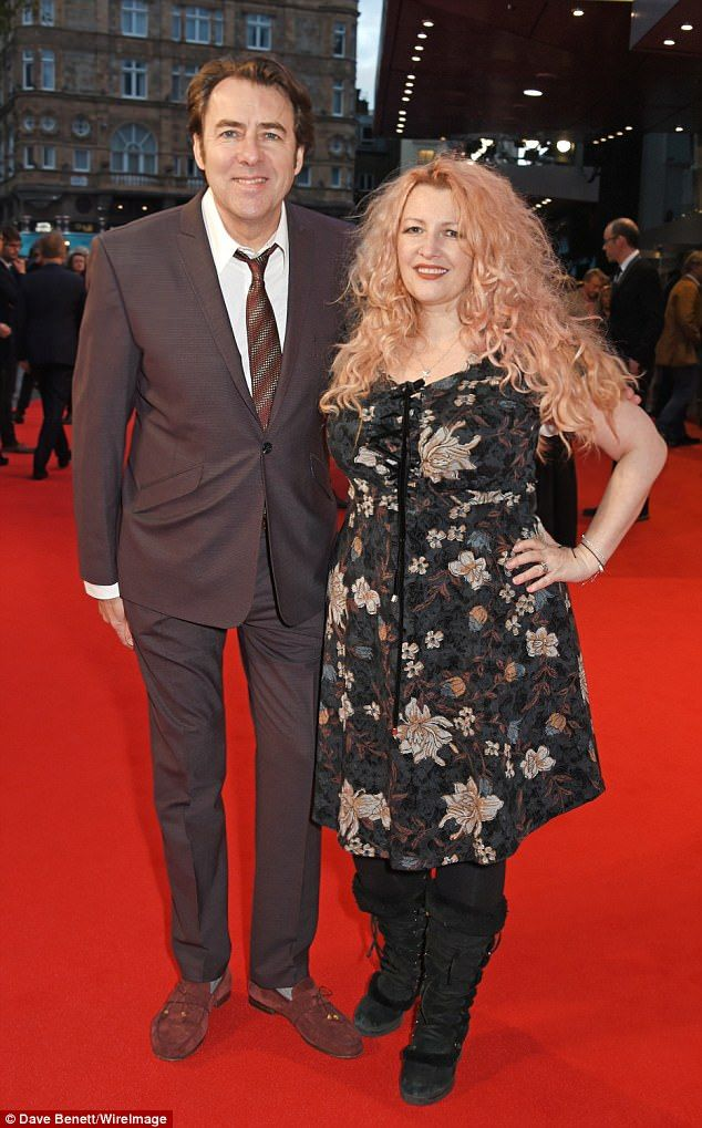 Loved-up: Comedian Jonathan Ross, 56, looked incredibly loved with his glamorous wife Jane Goldman, 47, as they led the stars at the Downsizing movie premiere in London on Friday