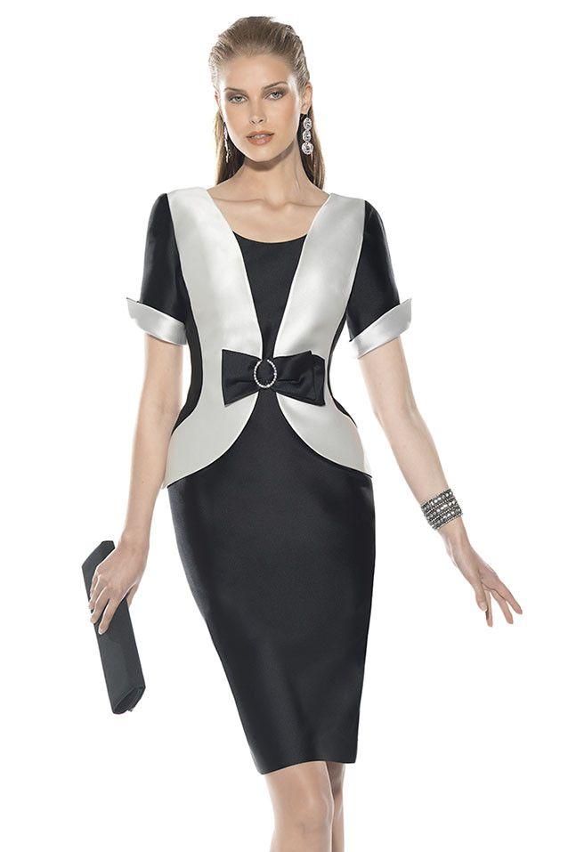 Vestido de fiesta para madrinas con manga corta, realizado en mikado negro y blanco con efecto chaqueta y acabado en...