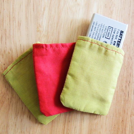 Fun sewing project for using up fabric scraps and organizing your camera batteries! These mini reversible bags are easy and quick to make.
