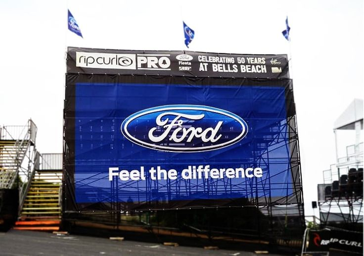 Vinyl mesh banner with reinforced eyelets on a portable grandstand