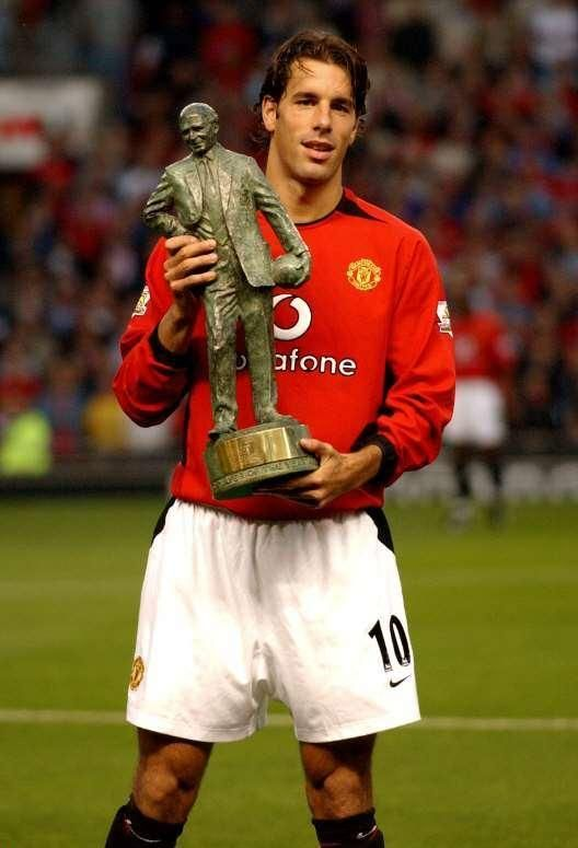Ruud van Nistelrooy displayed his Player of the Year trophy for 2002-03 season to the Old Trafford crowd 27th August 2003.