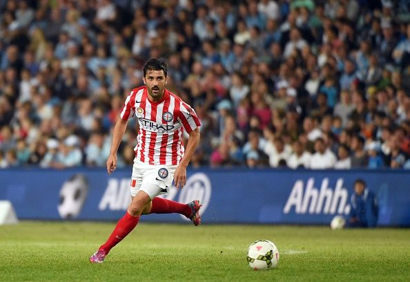 Melbourne City's Spanish player David Villa runs with the ball in his first match for the team against Sydney FC in their Australian A-League football match in Sydney on October 11, 2014.