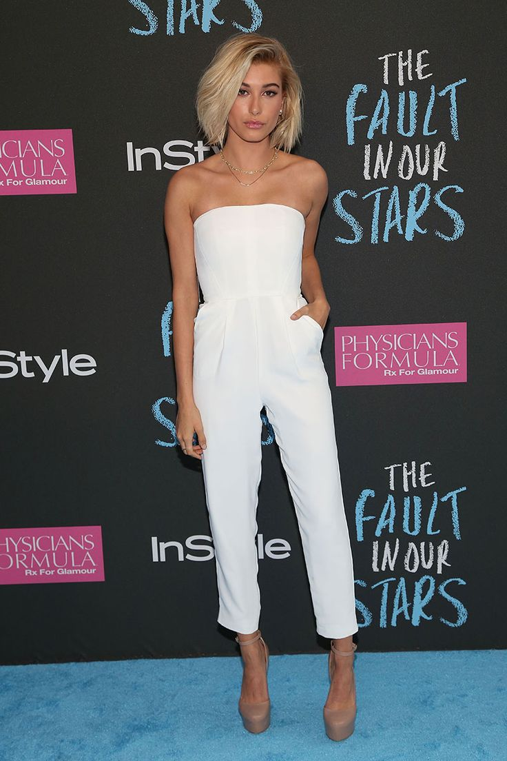 Hailey Baldwin looking chic in a white romper, bouncy bob and nude lips/shoes