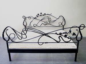 iron bed....do I see a rabbit as part of the headboard  and two in the footboard?