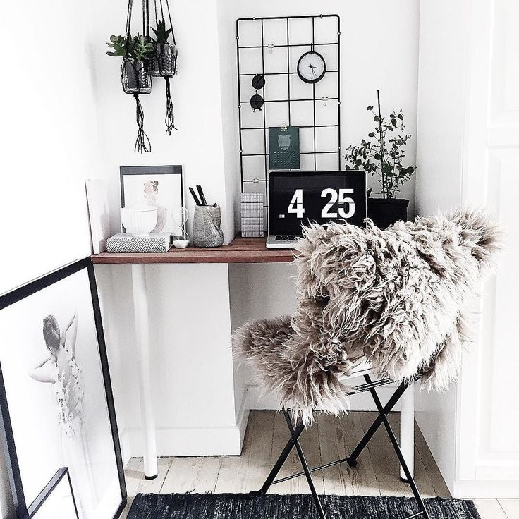 Minimal office nook with cozy fur chair.