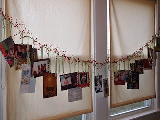 Christmas card display. She used key ring holders on each card, tied ribbon on and hung from a garland.