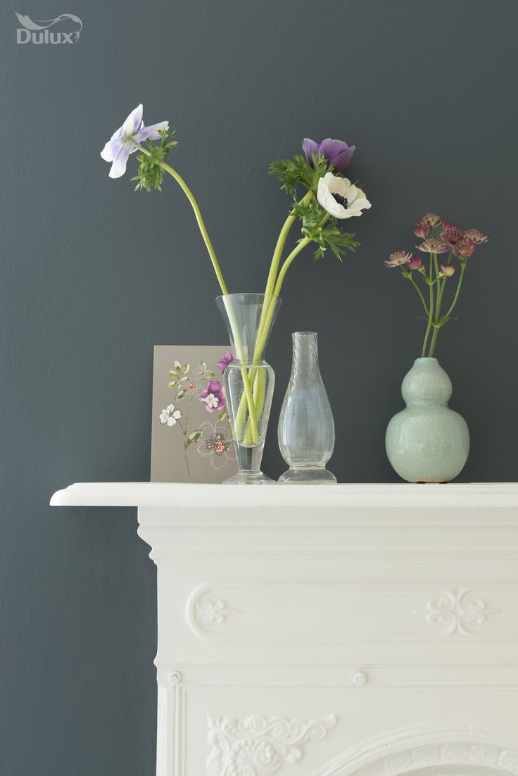 Offset a dark grey wall with pale woodwork and colourful flowers. This is Dulux Smokey Slate.