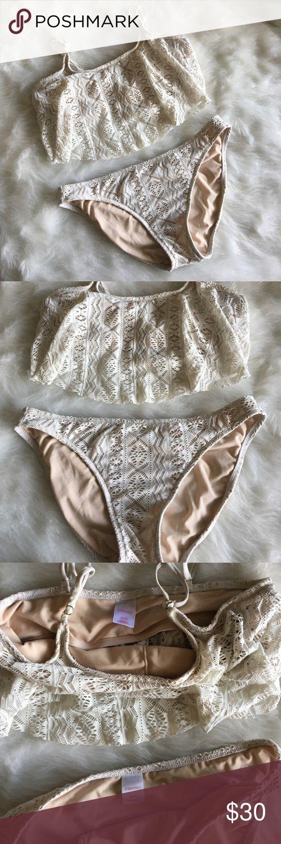 Cream lace bikini set Off white lace bikini set with ruffle top! Nude underlying lining. Top has adjustable straps. See photos for measurements Xhilaration Swim Bikinis