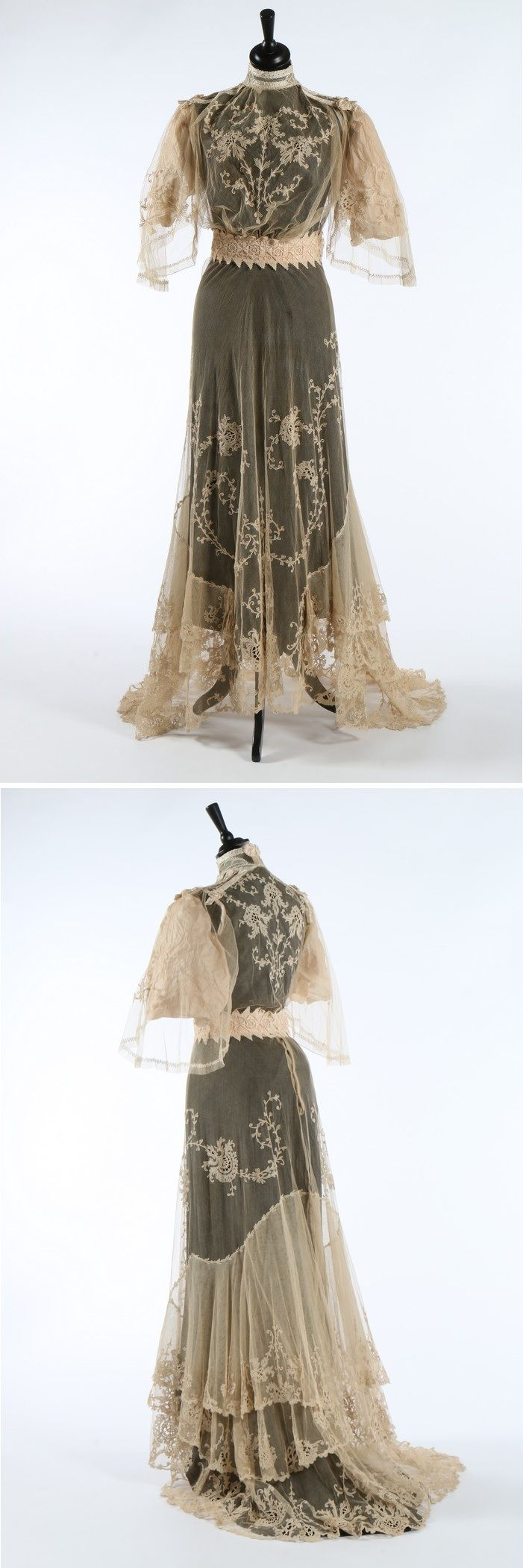 An embroidered lace bridal gown, circa 1905-10. the bodice slightly bloused at the front, embroidered silk bands to high neck and shoulders, later added chemical lace waistband, matching trained skirt.