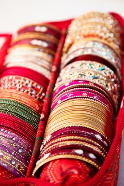 Or instead of favors, we could have a bangles bar, where they pick up their nametag and pick a set of bangles to keep