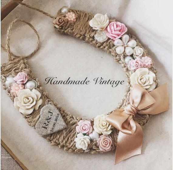 These stunning horseshoes are wrapped with twine and backed with luxury paper and embellished in luxury resin flowers & embellishments , to compliment your colour scheme. A combination of resin and mulberry flowers mixed with elegant pearl embellishments create a chic look still perfect for a rustic wedding. As a finishing touch, a small linen heart is personalised with initials of the couple and their wedding date. All horseshoes come in a personalised box.  These horseshoes are perfect...