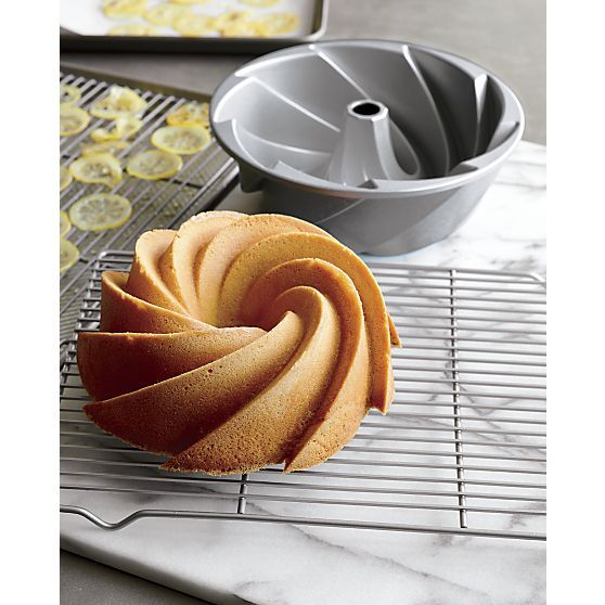 Nordic Ware honors their heritage with this sophisticated take on their signature Bundt pan. Durable cast aluminum pan with a dynamic modern swirl design and proprietary platinum nonstick finish cooks quickly and evenly and releases beautifully shaped cakes that require no additional decoration.