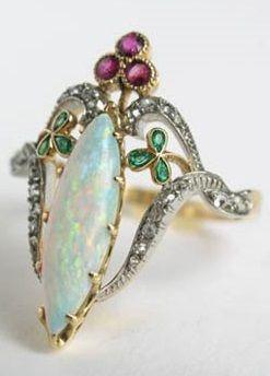 An Art Nouveau gold, opal, diamond, emerald and ruby ring, circa 1900, France. #ArtNouveau #ring