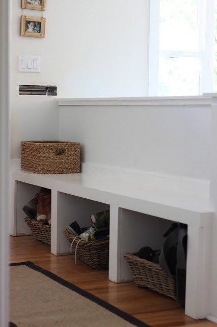 Ideas to add a built in bench or storage to an entryway that is open to the living room.