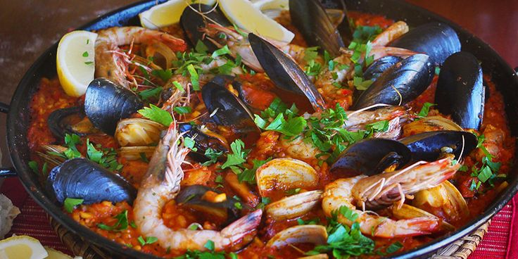 Paella | a great dish to serve straight to the dining table in the pan, drizzled with a little olive oil, and scattered with parsley and lemon wedges.